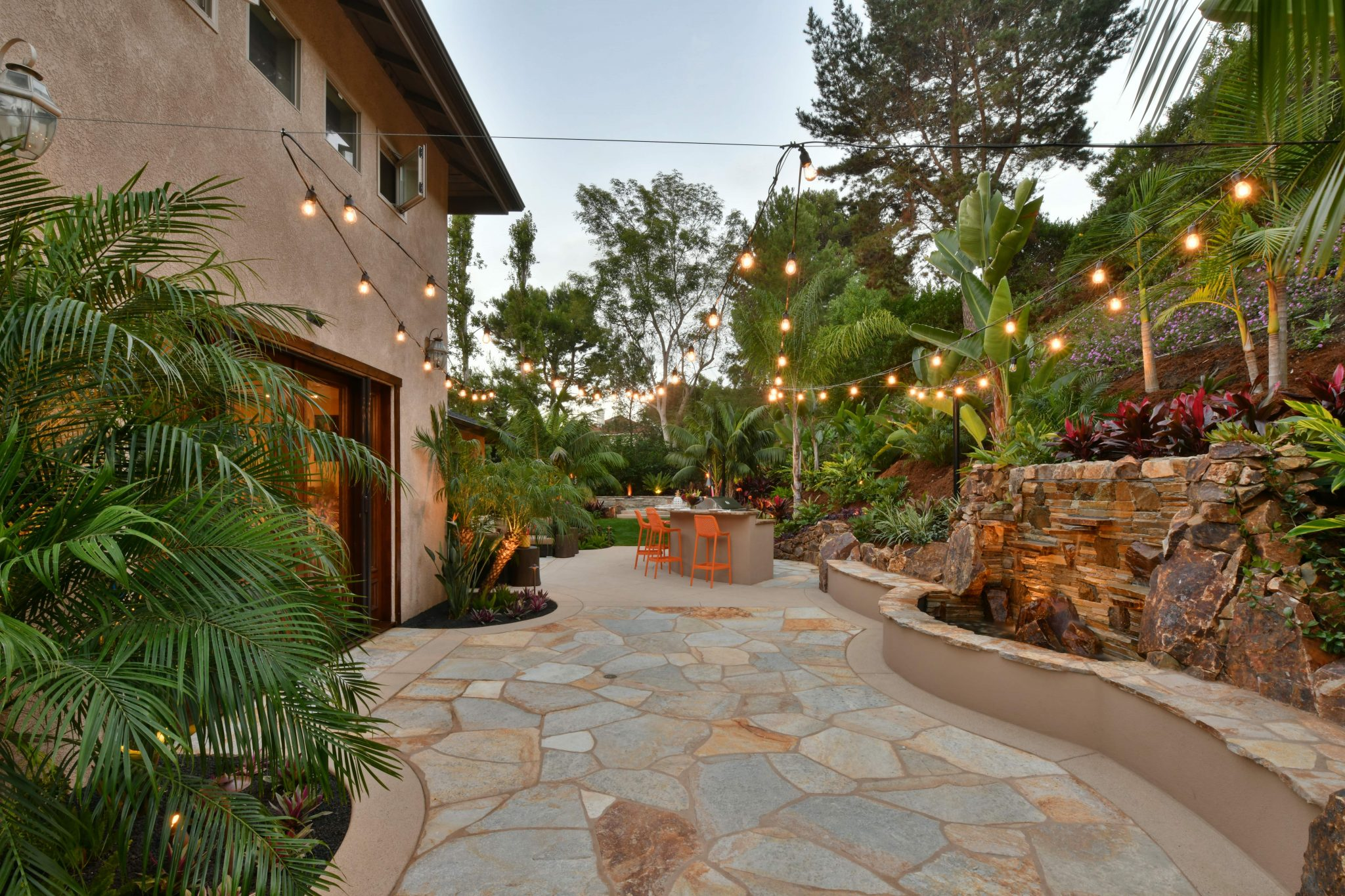 twinkle lights over a beautifully landscaped backyard in del mar